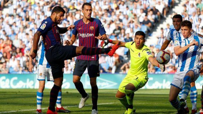 Barcelona melanjutkan start sempurnanya di Liga Spanyol dengan mengalahkan Real Sociedad