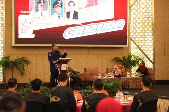 Silaturahmi Nasional (Silatnas) dan Temu Alumni Purna Praja Angkatan 12 Sekolah Tinggi Pemerintahan Dalam Negeri (STPDN), di Hotel Grand Claro, pada Sabtu (16/2/2019).