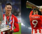 Fernando Torres membawa trofi Liga Europa