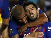 Luis Suarez merayakan gol ke gawang Arsenal (c) AP Photo