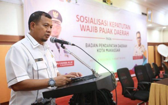 Sosialisasi Kepatuhan Pajak Daerah yang diadakan di hotel Singgasana