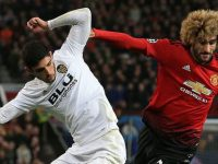 Fellaini dan Guedes. (c) AFP
