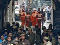 Area tempat pabrik berada di antara lorong-lorong sempit sehingga menyulitkan para petugas pemadam untuk mematikan api. - Reuters