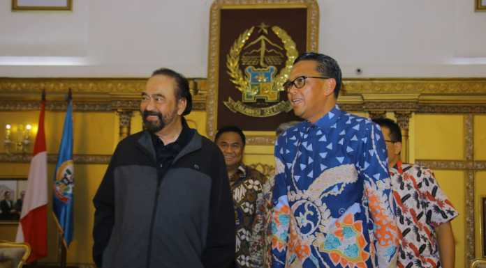 Surya Paloh bersama Gubernur Sulsel Prof Nurdin Abdullah.