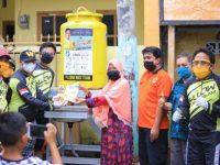 Yellow Bike Partai Golkar Gelar Aksi Sosial Pasang Alat Cuci Tangan untuk Warga