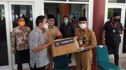 Abdul Rahim Salurkan Bantuan Masker dari DPP Partai Nasdem di Polman